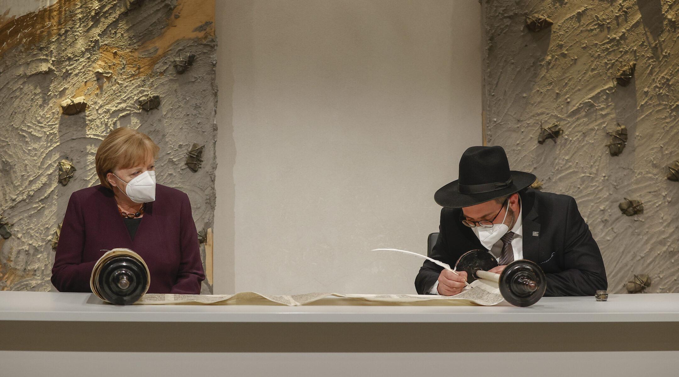 German Chancellor Angela Merkel Observes Finishing Of Historic Torah Scroll